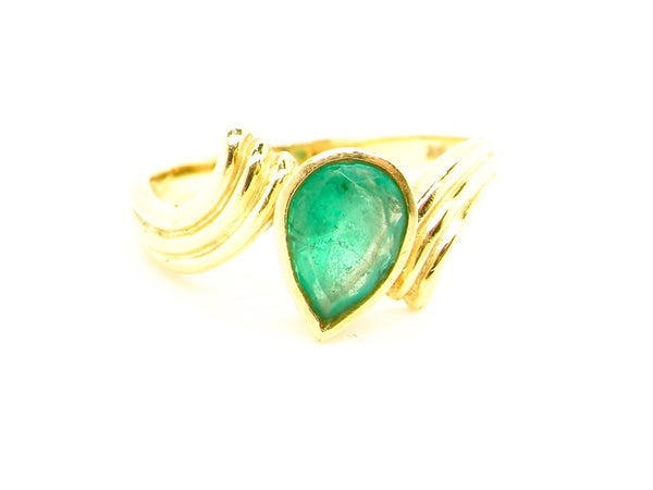 A modern pear shaped emerald dress ring