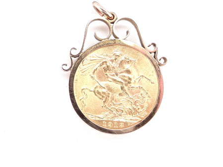 A George V full sovereign cased as a pendant