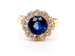 A stunning sapphire and diamond cluster ring *RESERVED*