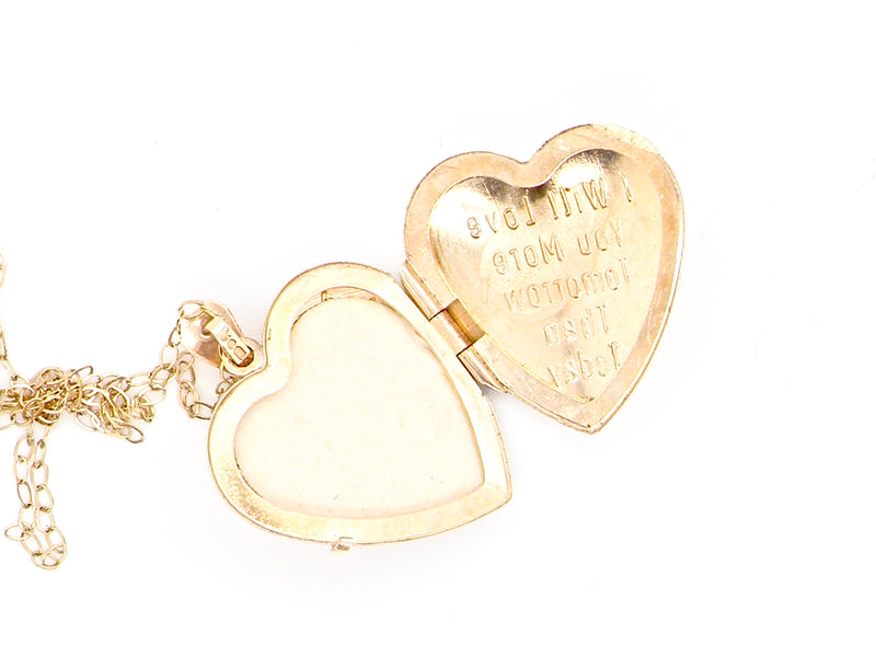 A 9 carat gold heart shaped locket