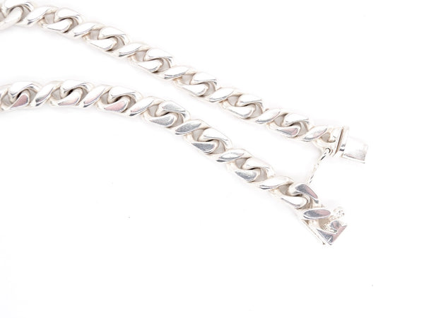 A heavy figure eight silver neck chain