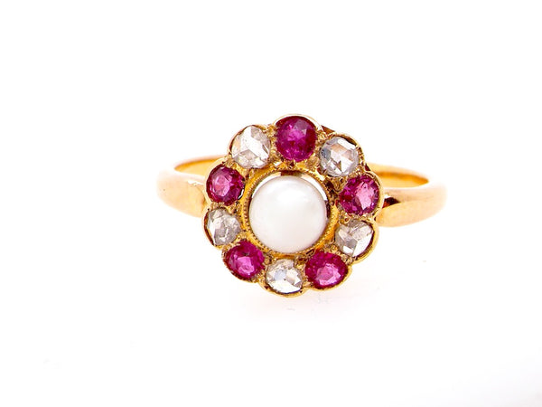 An Edwardian pearl, diamond and ruby cluster ring