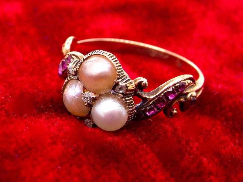 An antique pearl and ruby dress ring