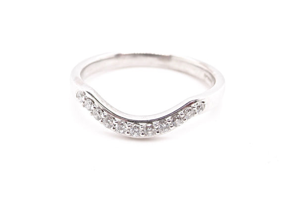 An 18 carat white gold shaped diamond ring