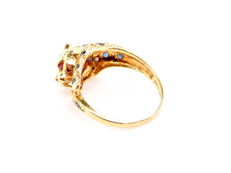 An 18 carat gold sapphire and diamond leopards head ring