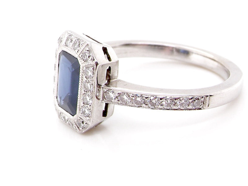 An 18 carat white gold sapphire and diamond cluster ring
