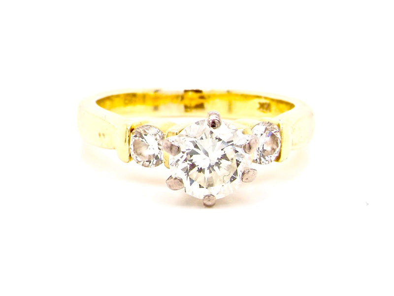 An 18 carat gold solitaire diamond ring