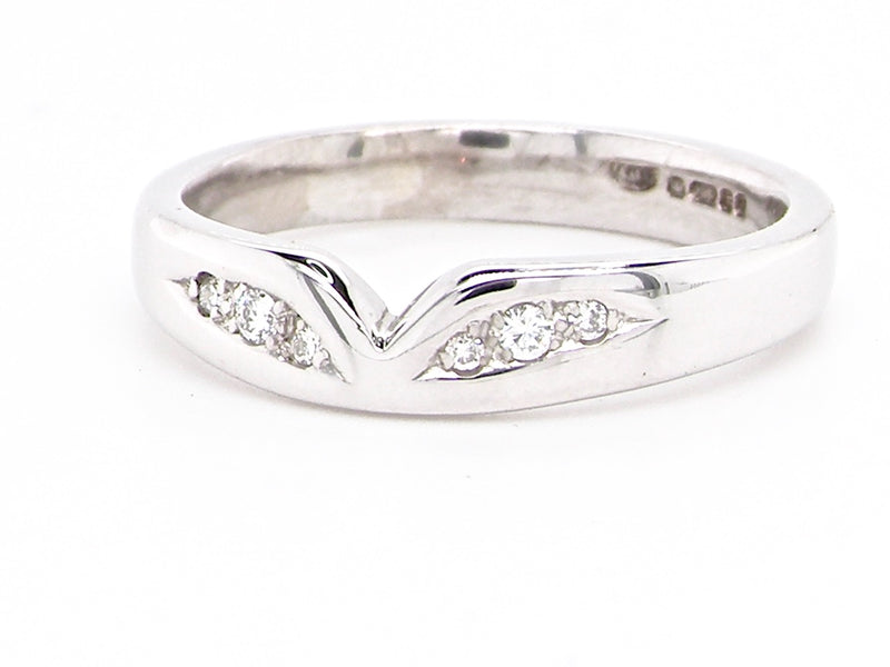 An 18 carat white gold shaped diamond set wedding ring