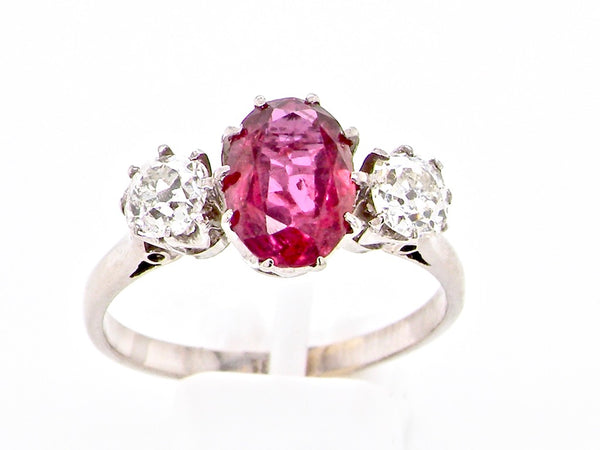 A 18 carat white gold ruby and diamond three stone ring