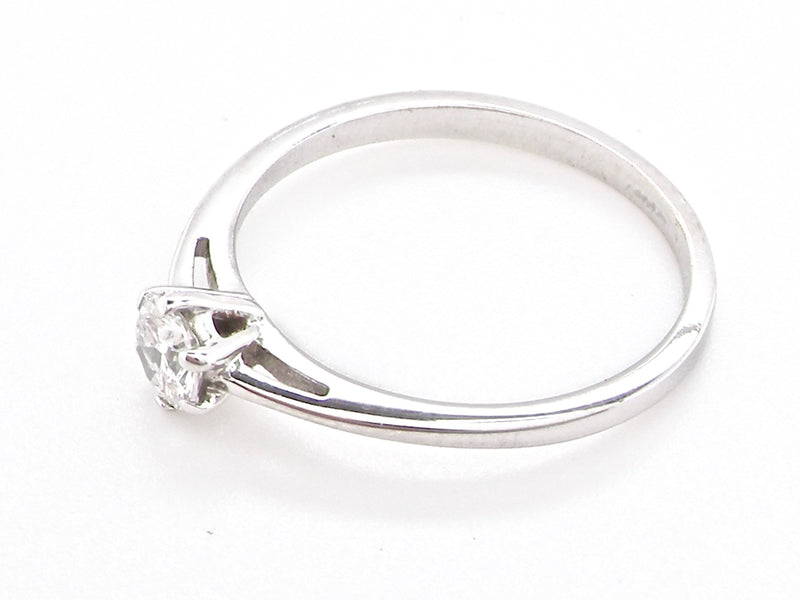 A quarter carat solitaire white gold diamond ring