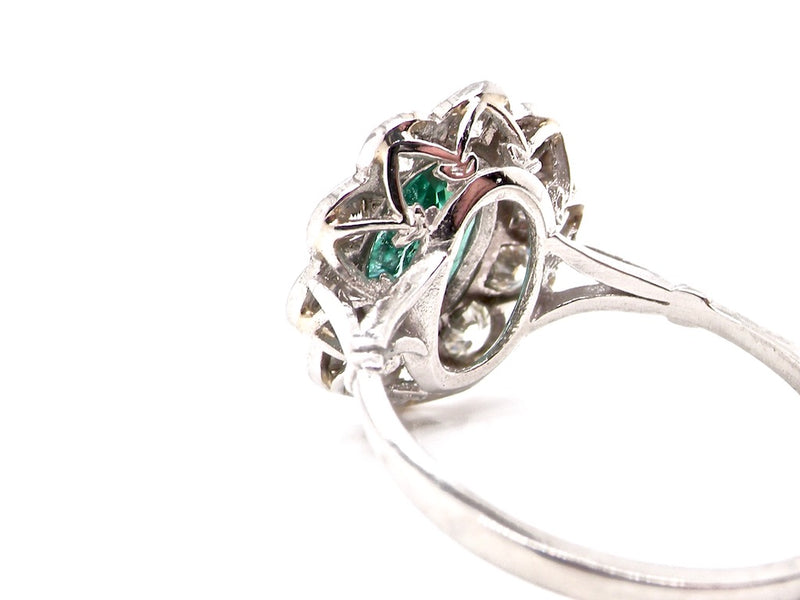 A lovely emerald and diamond cluster ring