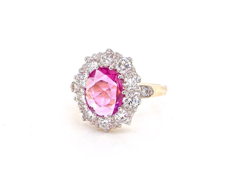 A pink sapphire and diamond cluster ring