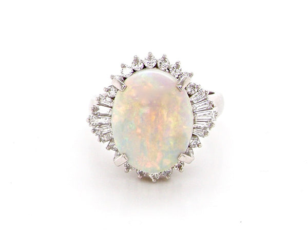 A platinum opal and diamond cluster ring