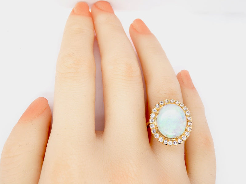 An Impressive opal and diamond cluster ring