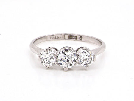 A traditional three stone diamond ring