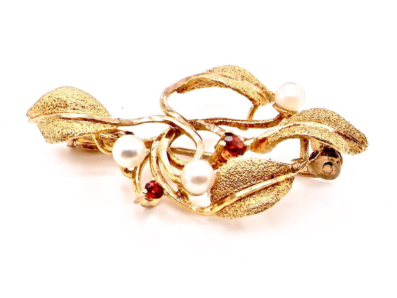 A 9 carat gold pearl and garnet brooch