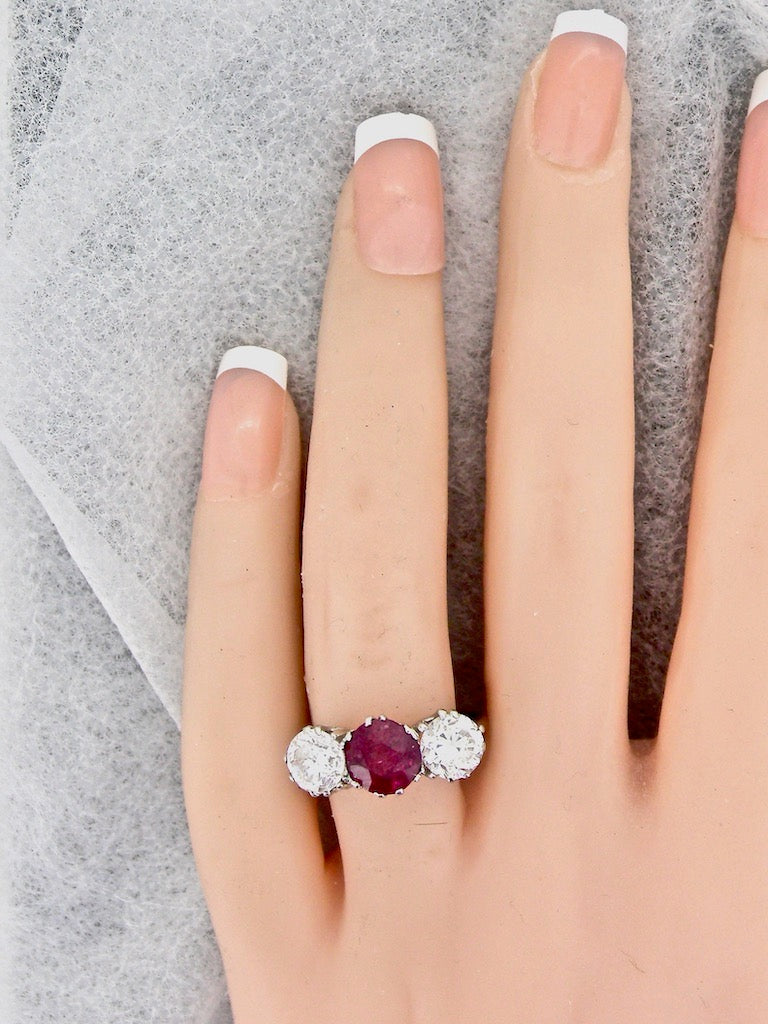 A fabulous three stone ruby and diamond ring