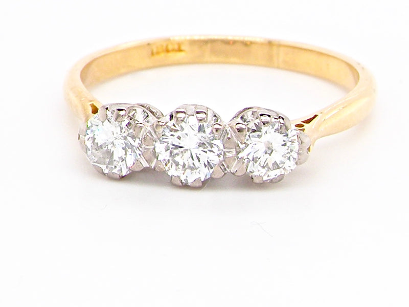 A half carat three stone diamond ring