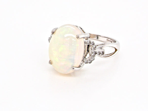 An opal and diamond dress ring
