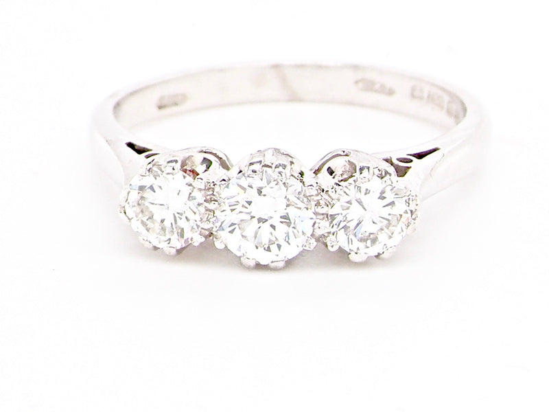 An 18 carat white gold three stone diamond ring