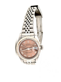 A lady's steel Rolex with salmon pink dial