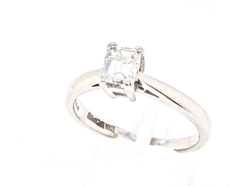 A half carat emerald cut solitaire diamond ring