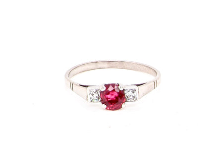 A vintage ruby and diamond three stone ring