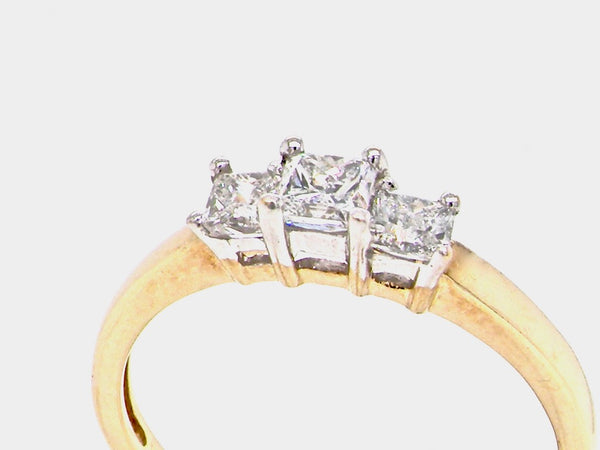 A three stone princess cut trilogy ring