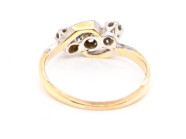 A vintage three stone cross over style ring