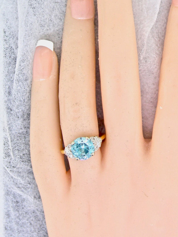 A natural blue zircon and diamond ring