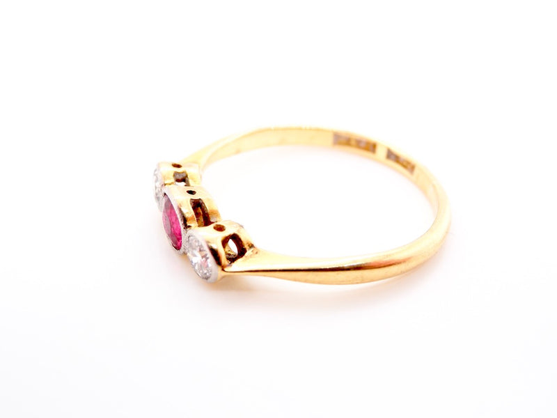 A vintage three stone ruby and diamond ring