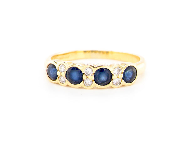 An 18 carat gold sapphire and diamond half hoop ring