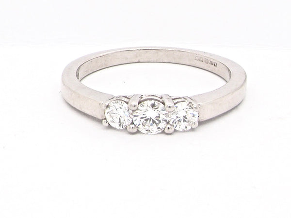 A modern three stone diamond ring