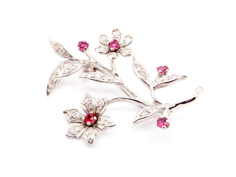 An 18 carat white gold ruby and diamond brooch