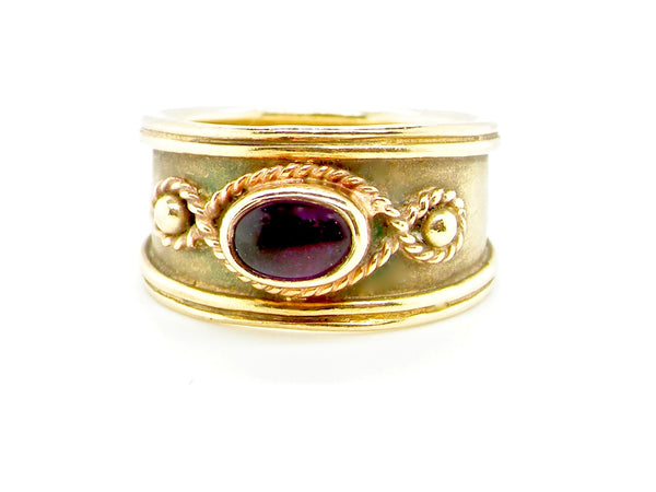 An antique style amethyst dress ring