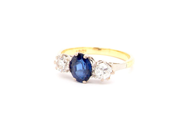 A tradtional three stone sapphire and diamond ring