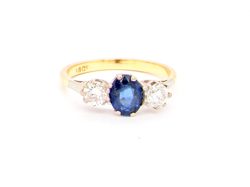 A traditional three stone sapphire and diamond ring