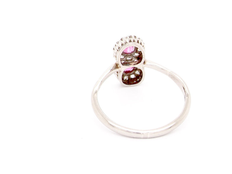 An 18 carat double cluster ruby and diamond ring