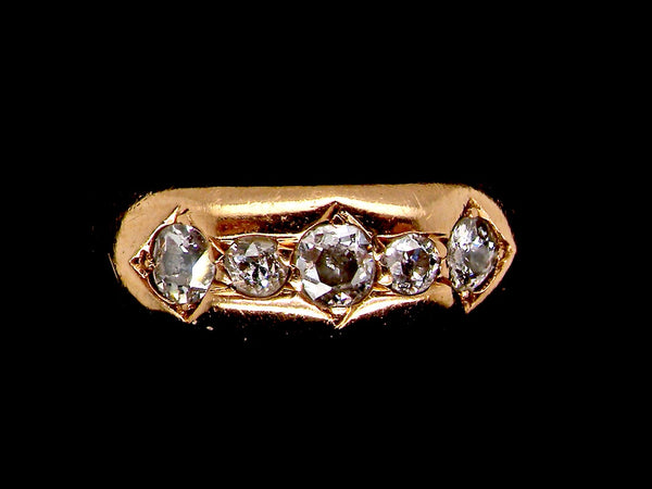 A five stone diamond 'gypsy' style ring