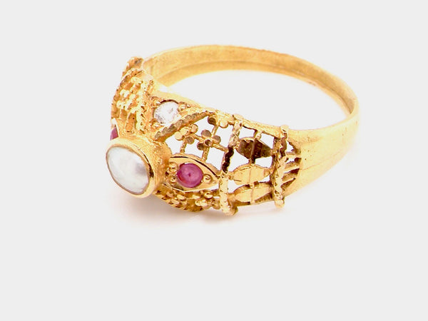 A high carat gold ruby and pearl dress ring