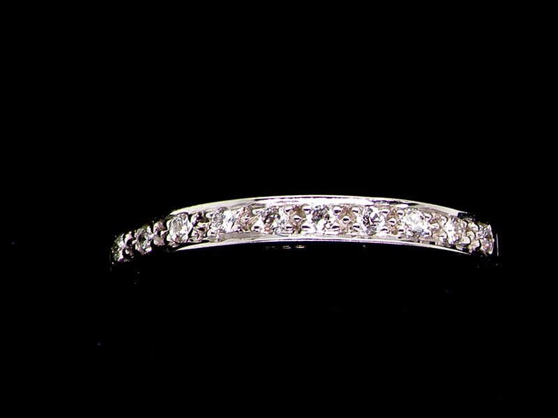 An 18 carat white gold diamond half hoop eternity ring