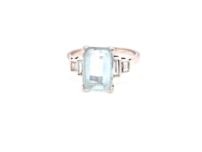 A platinum aquamarine and diamond ring