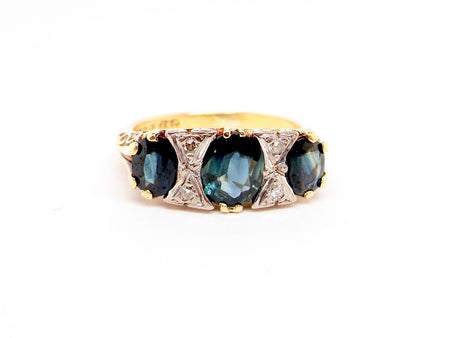 An 18 carat gold sapphire and diamond victorian style ring