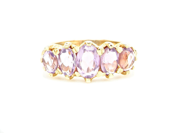 A five stone amethyst dress ring