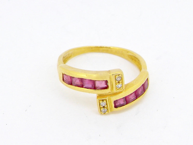 A ruby and diamond cross over ring