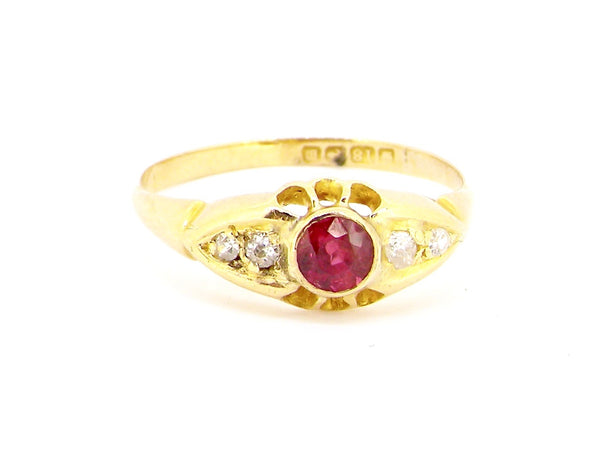 An 18 carat gold vintage ruby and diamond ring