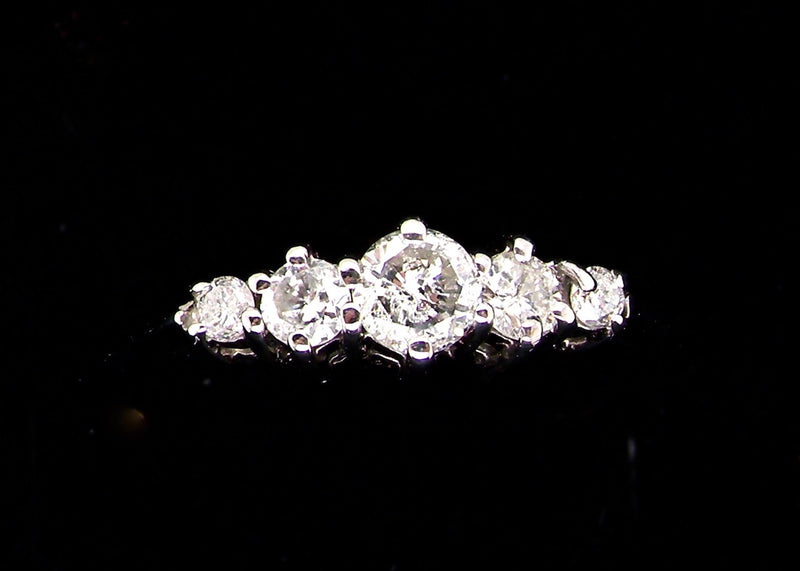 A 9 carat white gold five stone diamond ring