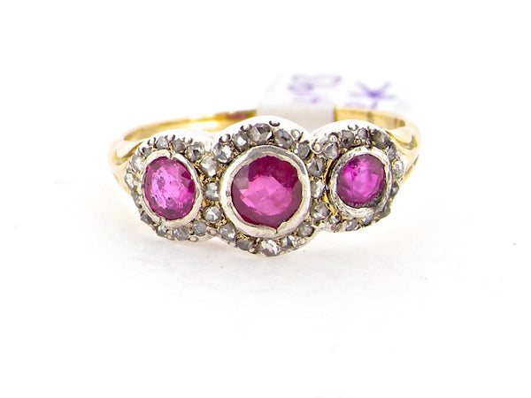 An antique ruby and diamond triple cluster ring