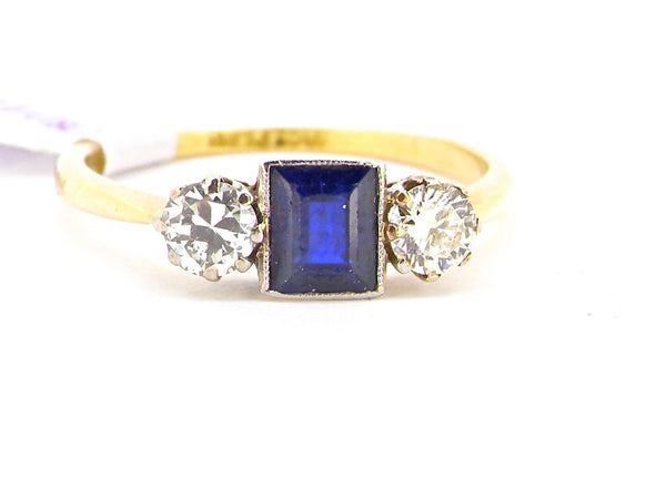 A vintage three stone sapphire and diamond ring