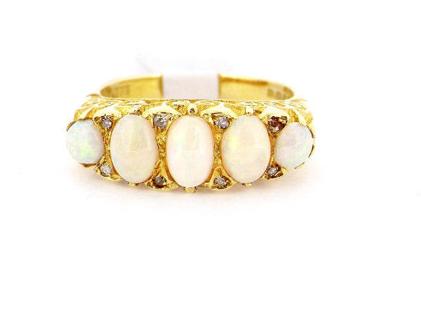 An 18 carat gold five stone opal ring